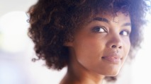 Closeup shot of a beautiful young woman with curly hair